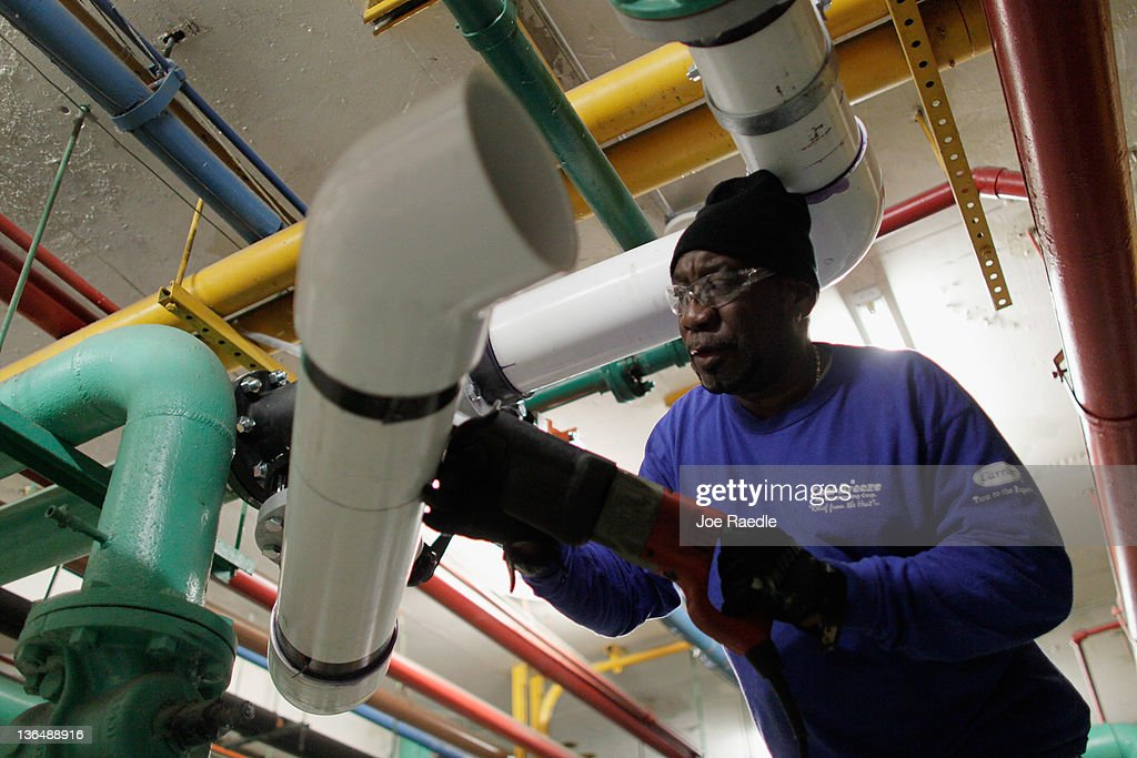 Pipefitter, Mike Turner, who was recently hired by Cool-Breeze Air Conditioning, works on installing an air conditioner in a hotel on January 6, 2012 in Miami Beach, Florida. The most recent jobs report for the month of December indicated that 200,000 new jobs were created in the month, and the unemployment rate dropped to 8.5 percent.
