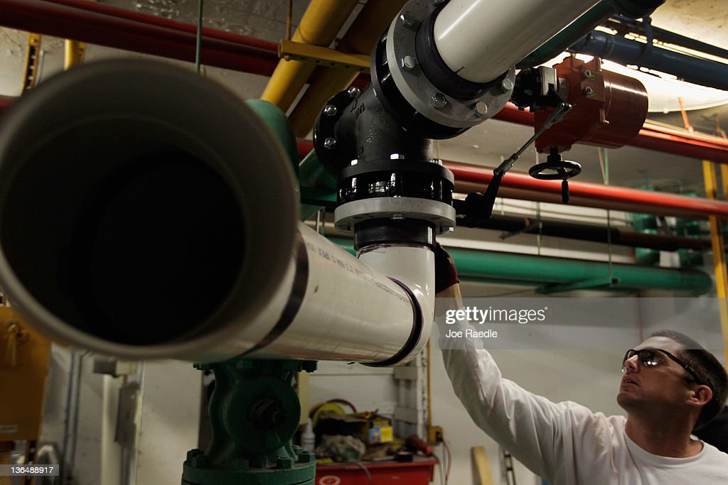 Pipefitter, Steve Andres, who was recently hired by Cool-Breeze Air Conditioning works on installing an air conditioner in a hotel on January 6, 2012 in Miami Beach, Florida. The most recent jobs report for the month of December indicated that 200,000 new jobs were created in the month, and the unemployment rate dropped to 8.5 percent.