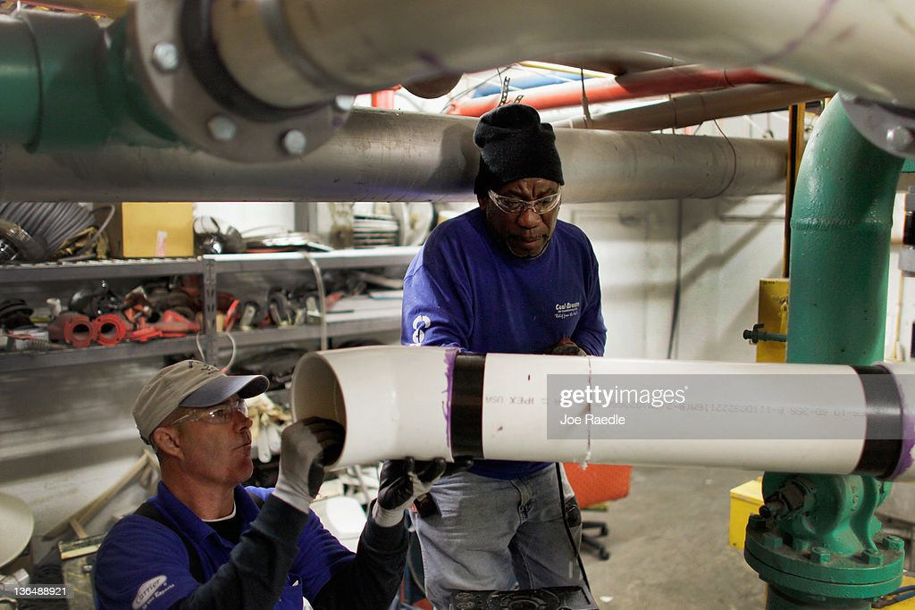 Pipefitters, Glenn Browne (L) and Mike Turner who were recently hired by Cool-Breeze Air Conditioning work on installing an air conditioner in a hotel on January 6, 2012 in Miami Beach, Florida. The most recent jobs report for the month of December indicated that 200,000 new jobs were created in the month, and the unemployment rate dropped to 8.5 percent.