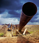 Oil & Gas Industry Pipeline being laid under ominous Storm Clouds.