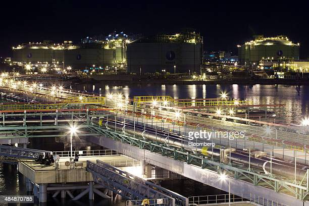 Pipelines run from the dock to liquefied natural gas storage tanks at night at the Korea Gas Corp LNG terminal in Tongyeong South Korea on Monday...
