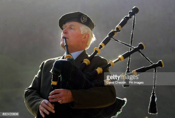Piper Andrew Forbes plays the bagpipes outside the Scottish Parliament in Edinburgh