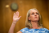 Piper Kerman author of 'Orange is the New Black My Year in a Women's Prison' is sworn in before testifying during the Senate Homeland Security and...