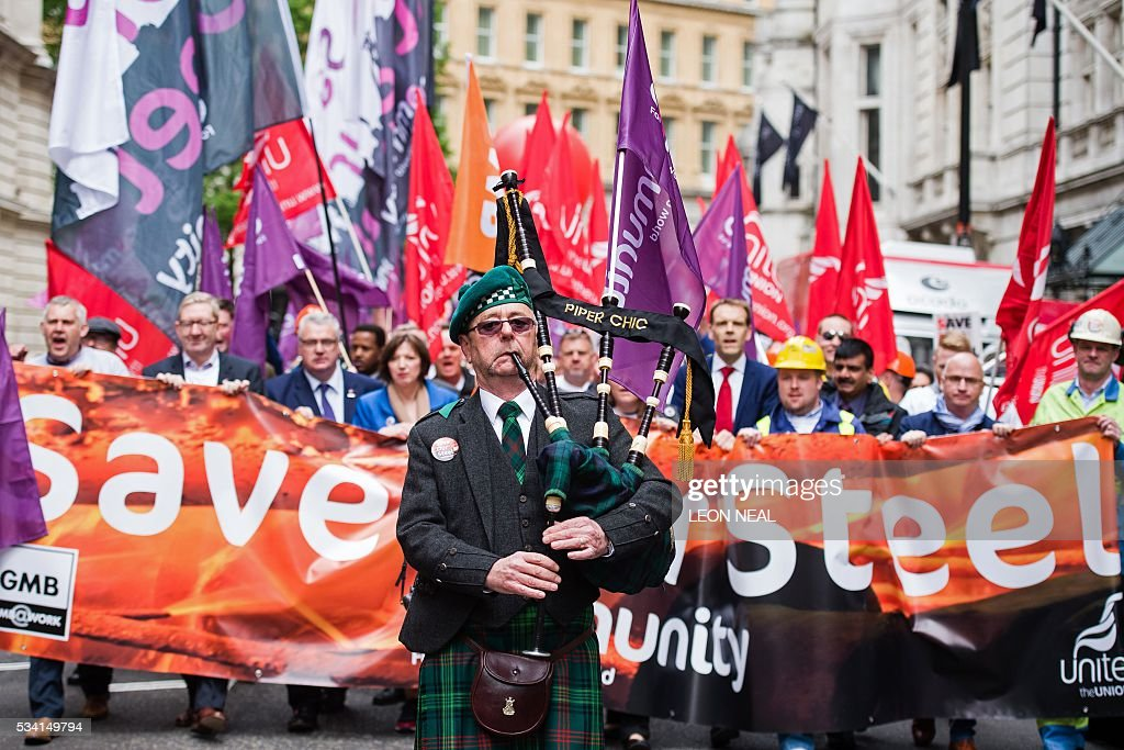 A piper plays as he leads steel workers during a protest march through central London on May 25, 2016. Britain's business minister Sajid Javid met Tata Steel bosses in Mumbai ahead of a crunch board meeting on Wednesday expected to discuss potential buyers for its loss-making UK assets. Tata Steel, Britain's biggest steel employer, announced in March that it planned to sell its Port Talbot plant in Wales and other assets, putting 15,000 jobs at risk. / AFP / LEON