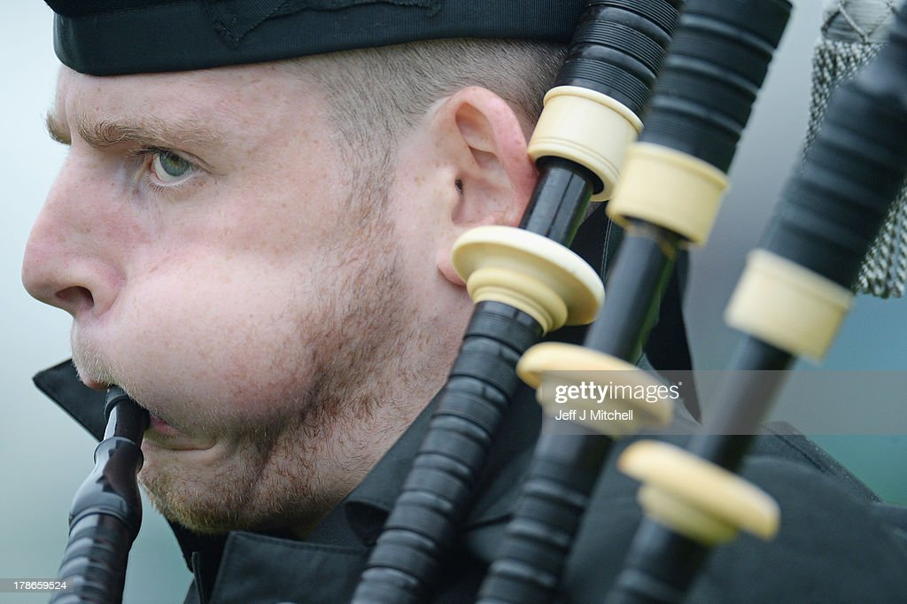 A piper plays during the solo piping at the Cowal Highland Gathering on August 30, 2013 in Dunoon, Scotland. First held in 1894, the Cowal Games are held over three days and are one of the largest in the world attracting competitors from Canada, USA, South Africa, Australia and New Zealand.