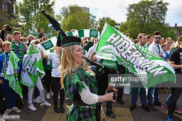 A piper plays Sunshine on Leith as Hibernian supporters gather at Leith Links at the end of their teams victory parade to celebrate yesterdays...