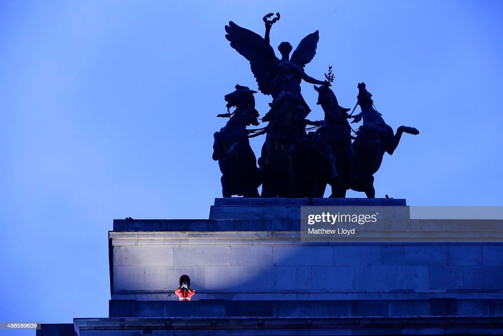 A piper sounds the Last Post during a dawn remembrance service at the Wellington Arch on ANZAC Day at Hyde Park on April 25, 2014 in London, England. It is the 99th anniversary of the Galipoli landings in which tens of thousands of servicemen died.