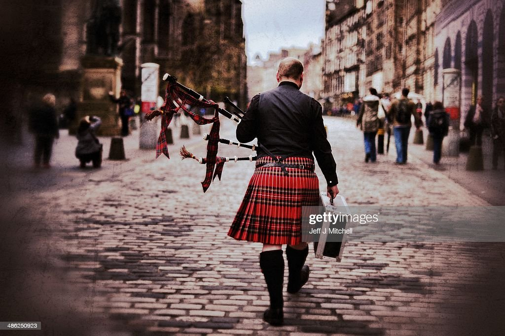 A piper walks up the Royal Mile on April 23, 2014 in Edinburgh, Scotland. A referendum on whether Scotland should be an independent country will take place on September 18, 2014.
