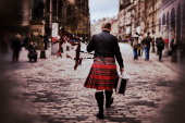A piper walks up the Royal Mile on April 23 2014 in Edinburgh Scotland A referendum on whether Scotland should be an independent country will take...