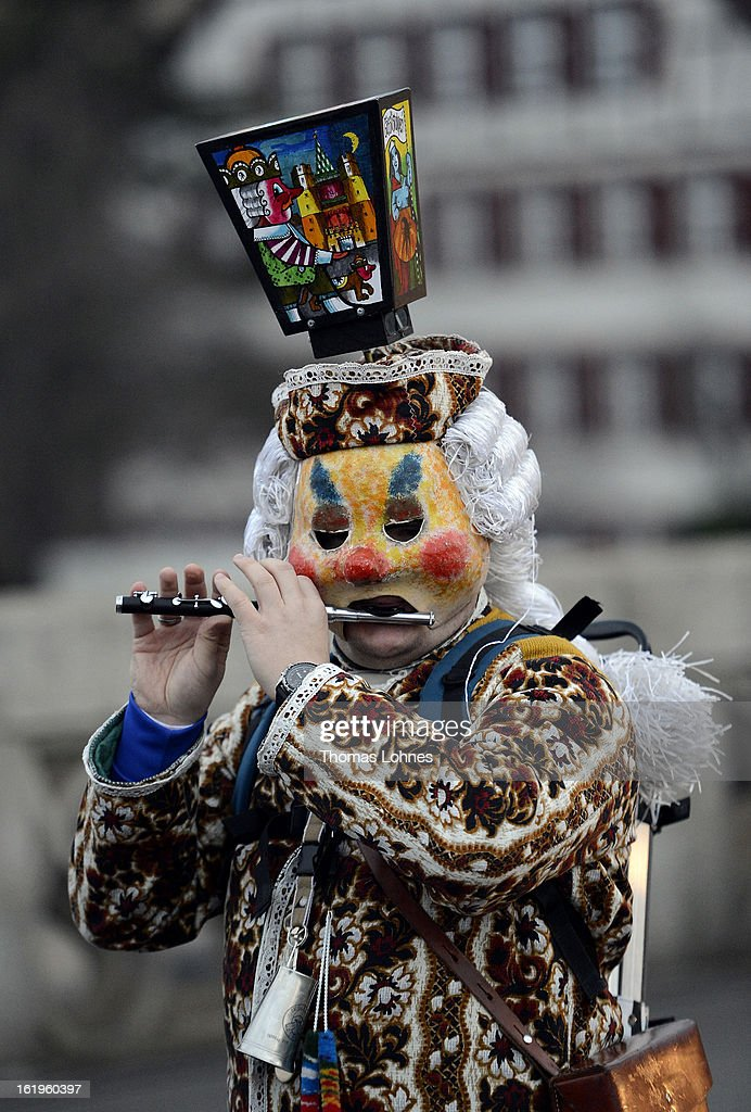 A piper with typical mask and lantern take part in the traditional 'Morgestraich' for the opening of the Basel Fasnacht Carnival on February 18, 2013 in Basel, Switzerland. More than 12,000 participants will take part in the largest carnival in Switzerland that lasts for 72 hours and will be watched by more than 100,000 spectators as it makes its way through the city center.