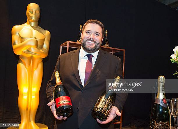 PiperHeidsieck Global Executive Director Benoit Collard poses with a limited Oscar edition bottle during the Oscar Governors Ball preview in...