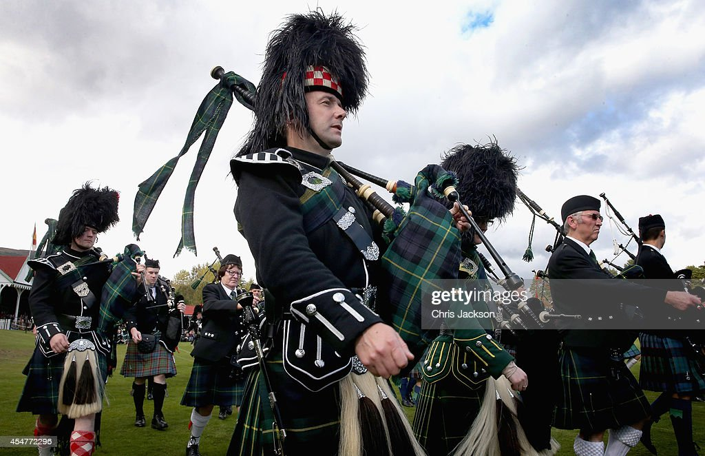 Pipers march during the Braemar Highland Games on September 2 2014 in Braemar Scotland The Braemar Gathering is the most famous of the Highland Games...
