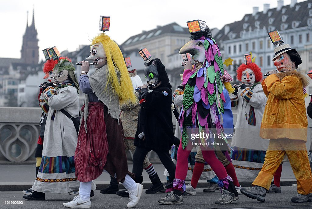 Pipers with typical masks and lanterns take part in the traditional 'Morgestraich' for the opening of the Basel Fasnacht Carnival on February 18, 2013 in Basel, Switzerland. More than 12,000 participants will take part in the largest carnival in Switzerland that lasts for 72 hours and will be watched by more than 100,000 spectators as it makes its way through the city center.