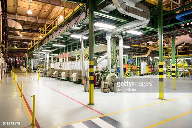 Pipes and industrial equipment inside aluminium processing plant