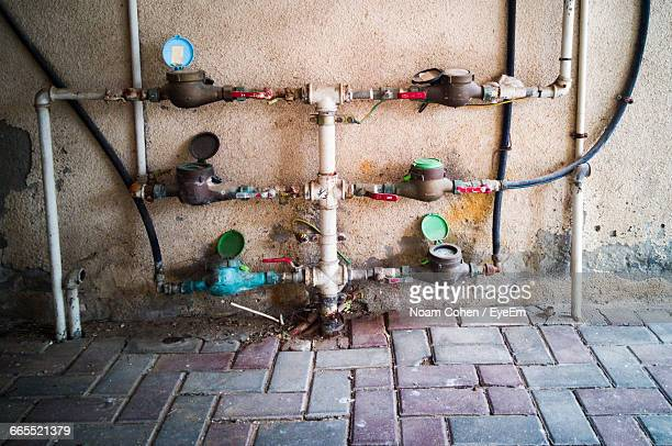 Pipes And Meters Against Wall