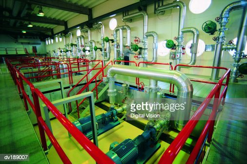 Pipes and valves in large room