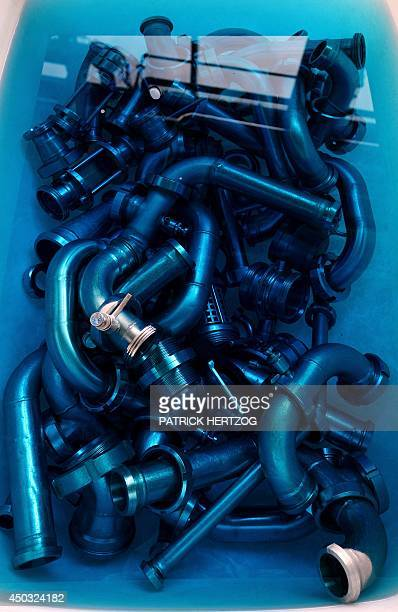 Pipes in a cleaning liquid are pictured on May 28 2014 at the Research and Development Centre of Kronenbourg main brewery in Obernai eastern France...