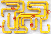 yellow gas pipes on a brick wall.