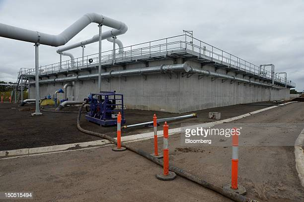 Pipes run along the perimeter of a wastewater storage facility at Barwon Region Water Corporation's Northern Water Plant constructed by John Holland...