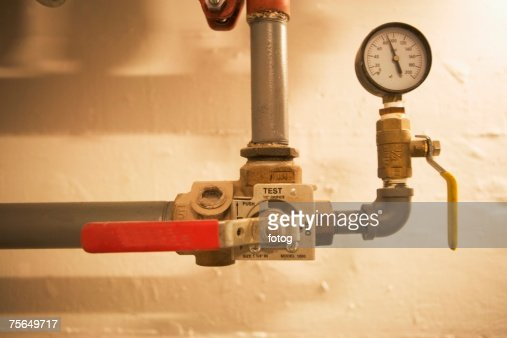 Pipes with pressure gauge and shutoff valve
