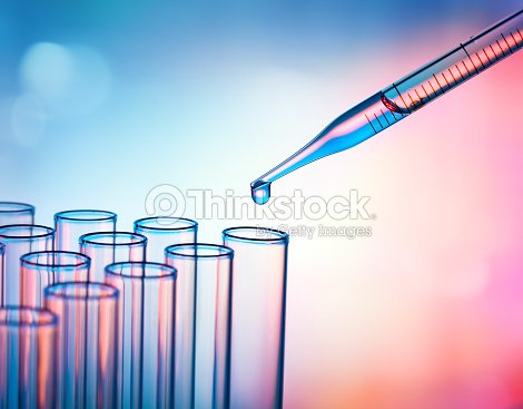 Pipette Dropping A Sample Into A Test Tube - Closeup : Stock Photo