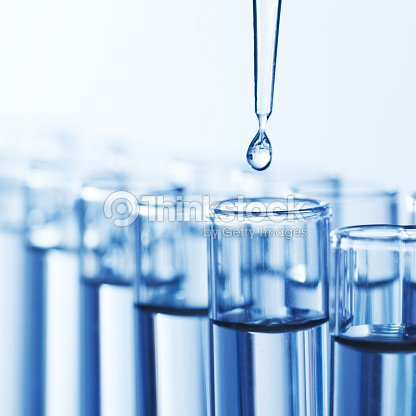 Pipette with drop of liquid : Stock Photo