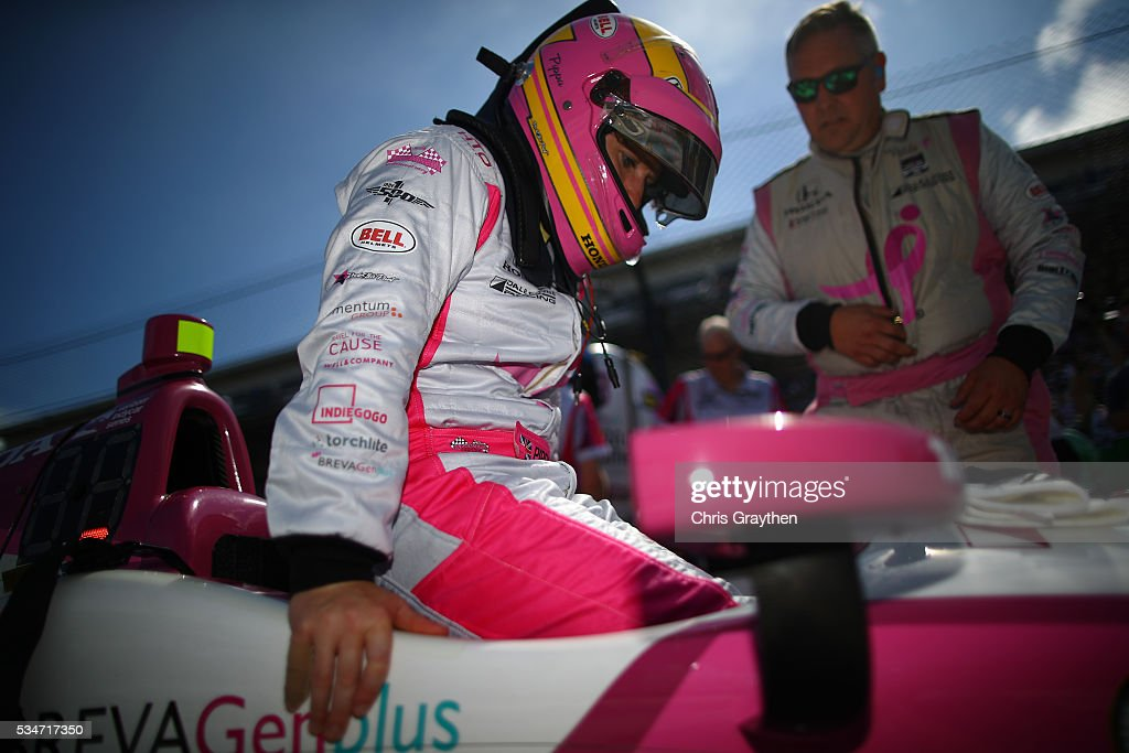 Pippa Mann of Great Britian, driver of the #63 Susan G. Komen Dale Coyne Racing Honda, prepares to drive on Carb Day ahead of the 100th running of the Indianapolis 500 at Indianapolis Motorspeedway on May 27, 2016 in Indianapolis, Indiana.