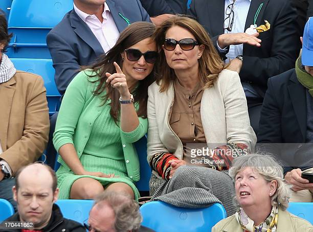 Pippa Middleton and Carole Middleton look on during the Men's Singles second round match between Andy Murray of Great Britain and Nicolas Mahut of...