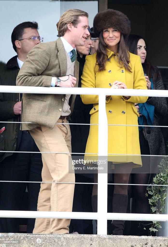 Pippa Middleton and friend Tom Kingston watch day 3 of the Cheltenham Festival at Cheltenham Racecourse on March 14, 2013 in Cheltenham, England.