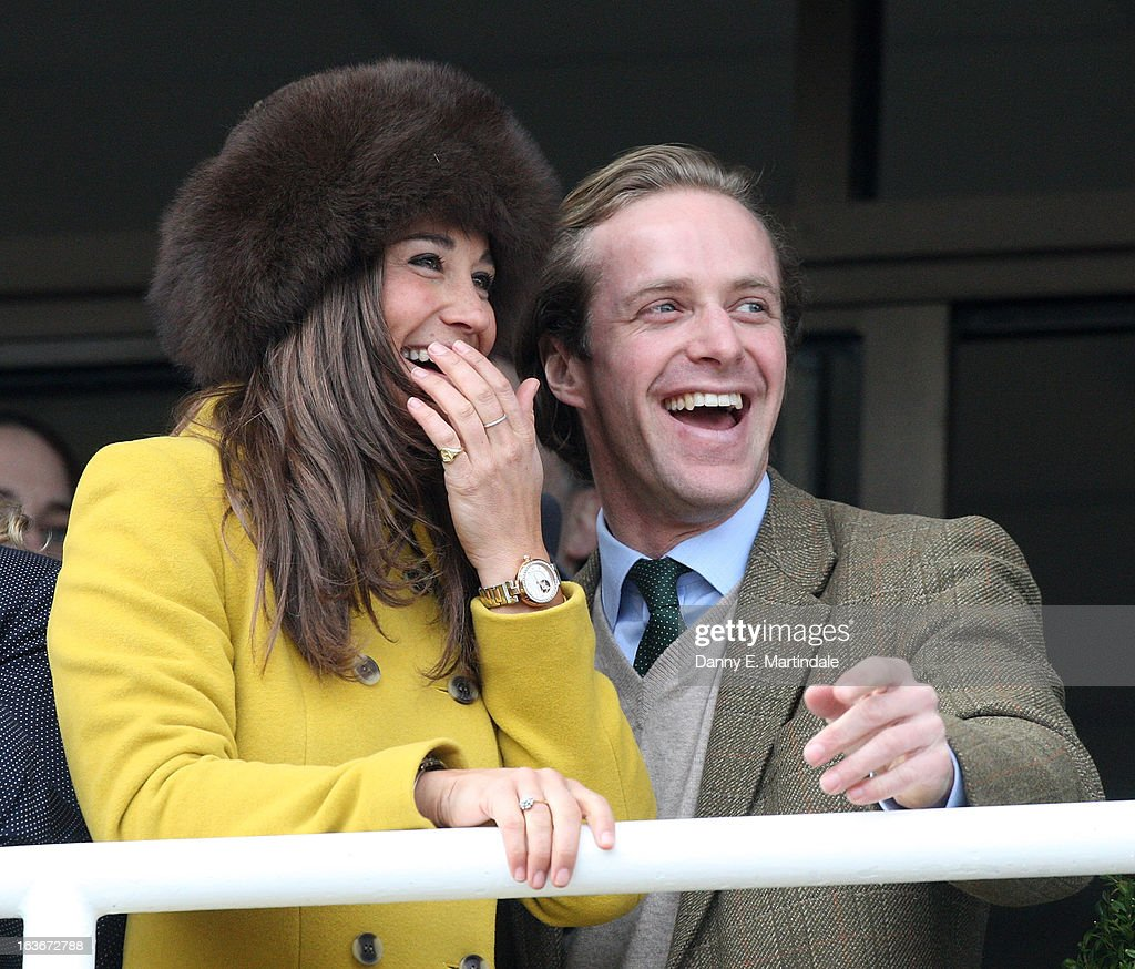 Pippa Middleton and friend Tom Kingston watch the Queens Mother Champion Steeple Chase on day 3 of the Cheltenham Festival at Cheltenham Racecourse on March 14, 2013 in Cheltenham, England.