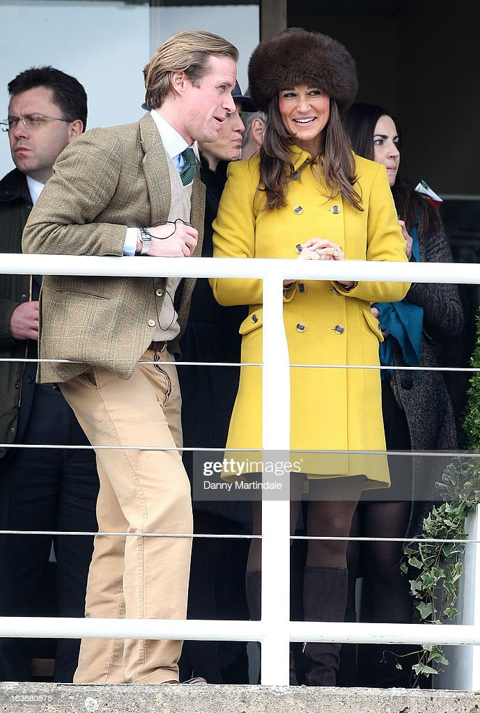 Pippa Middleton and friend Tom Kingston watch the races on day 3 of the Cheltenham Festival at Cheltenham Racecourse on March 14, 2013 in Cheltenham, England.