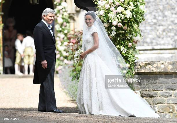 Pippa Middleton and her father Michael Middleton arrive at the wedding of Pippa Middleton and James Matthews at St Mark's Church on May 20 2017 in...