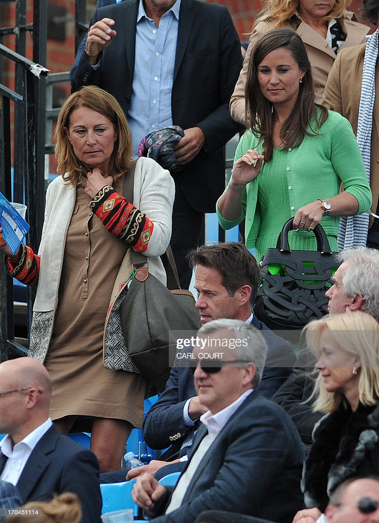Pippa Middleton (R) and her mother Carole Middleton, sister and mother of Britain's Catherine, Duchess of Cambridge, arrive to watch a tennis match between France's Jo-Wilfried Tsonga and Igor Sijsling of the Netherlands during their ATP Aegon Championships tennis match at the Queen's Club in west London, on June 13, 2013.