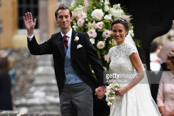 TOPSHOT Pippa Middleton and her new husband James Matthews leave St Mark's Church in Englefield west of London on May 20 2017 following their wedding...