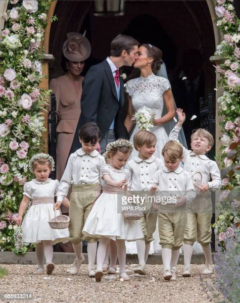 Pippa Middleton and James Matthews kiss after their wedding at St Mark's Church on May 20 2017 in Englefield England