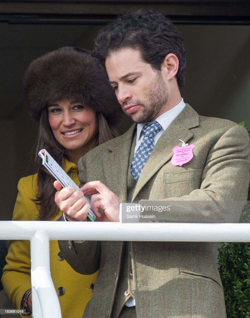 Pippa Middleton and Marcus Waley-Cohen watch the races from the balcony at the Cheltenham Festival Day 3 at Cheltenham racecourse on March 14, 2013 in London, England.
