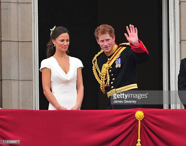 Pippa Middleton and Prince Harry greet crowd of admirers from the balcony of Buckingham Palace on April 29 2011 in London England