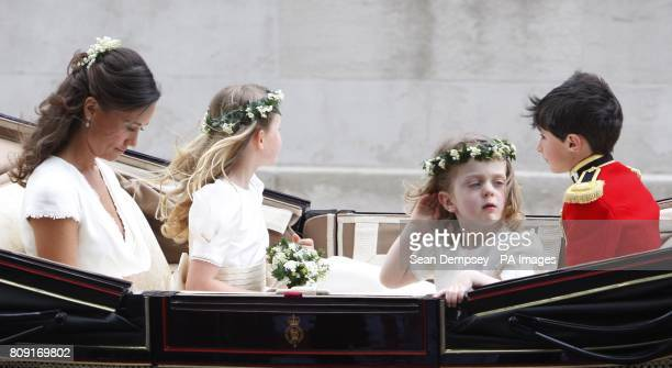 Pippa Middleton and the bridesmaids in a horse drawn carriage making their way up Whitehall to Buckingham Place following their wedding ceremony