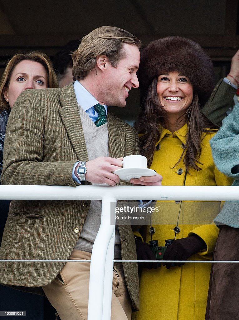 Pippa Middleton and Tom Kingston (L) watch the races from the balcony at the Cheltenham Festival Day 3 at Cheltenham racecourse on March 14, 2013 in London, England.