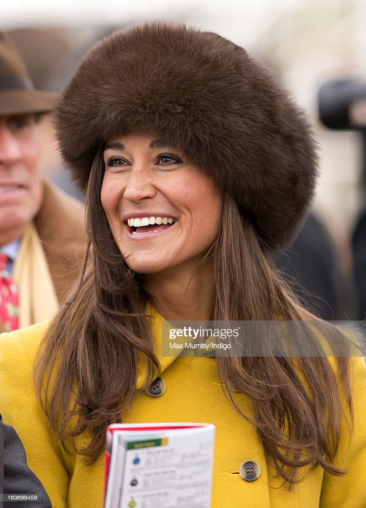 Pippa Middleton attends Day 3 of The Cheltenham Festival at Cheltenham Racecourse on March 14, 2013 in London, England.