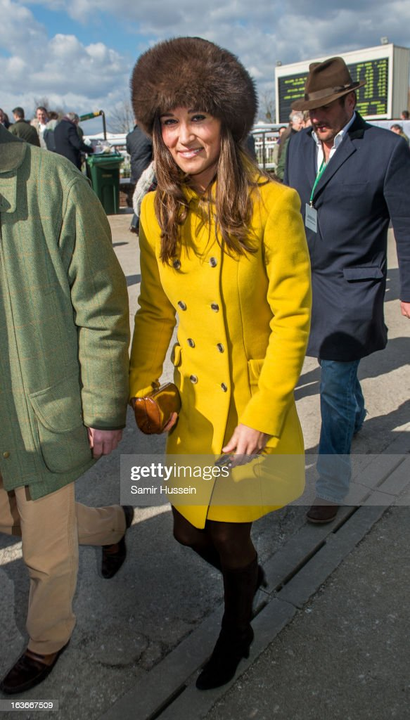 Pippa Middleton attends the Cheltenham Festival Day 3 at Cheltenham racecourse on March 14, 2013 in London, England.