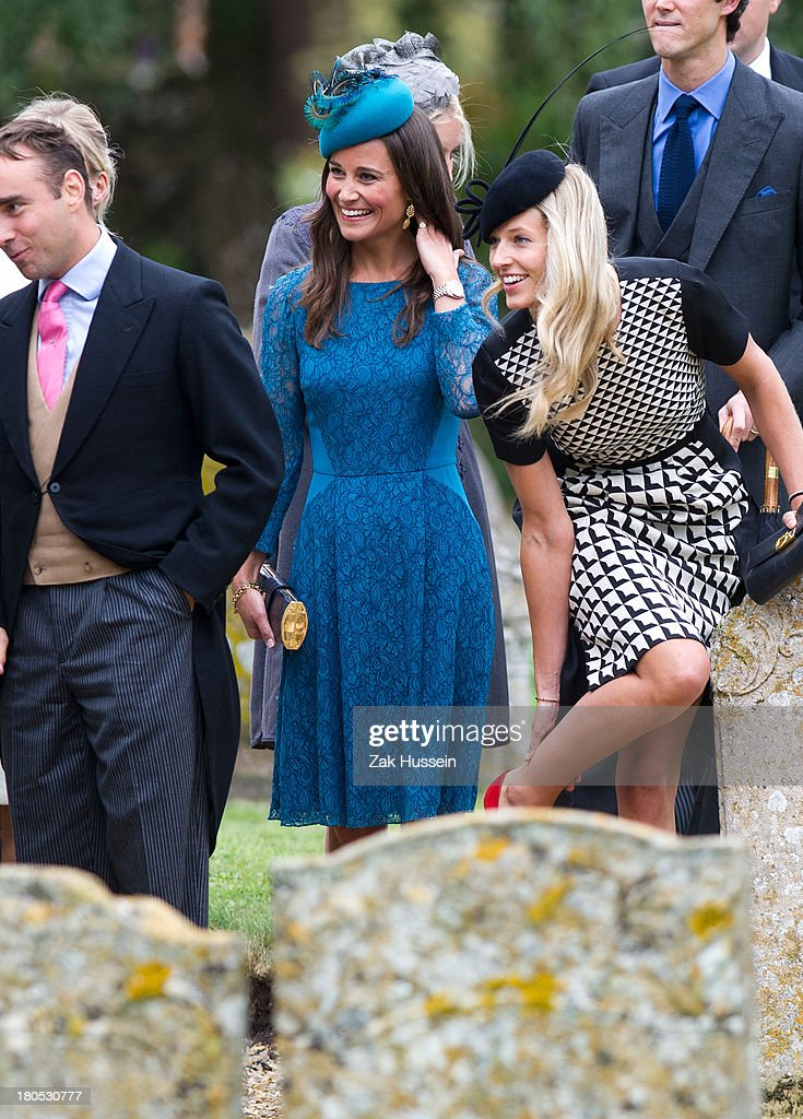 <a gi-track='captionPersonalityLinkClicked' href=/galleries/search?phrase=Pippa+Middleton&family=editorial&specificpeople=4289296 ng-click='$event.stopPropagation()'>Pippa Middleton</a> (C) attends the wedding of James Meade And Lady Laura Marsham at The Parish Church of St. Nicholas in Gaytonon September 14, 2013 in King's Lynn, England.