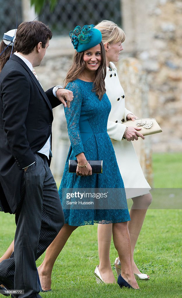 <a gi-track='captionPersonalityLinkClicked' href=/galleries/search?phrase=Pippa+Middleton&family=editorial&specificpeople=4289296 ng-click='$event.stopPropagation()'>Pippa Middleton</a> attends the wedding of James Meade and Lady Laura Marsham at the parish church of St Nicholas in Gayton on September 14, 2013 in King's Lynn, England.