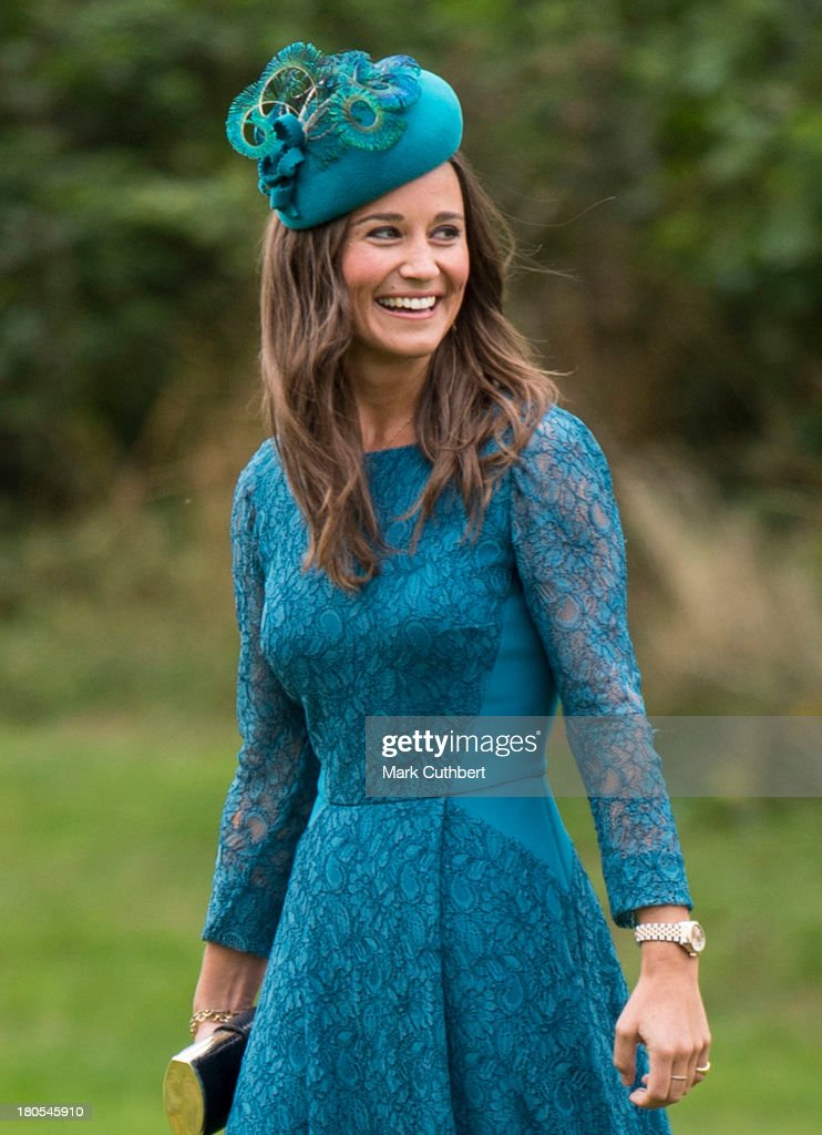 <a gi-track='captionPersonalityLinkClicked' href=/galleries/search?phrase=Pippa+Middleton&family=editorial&specificpeople=4289296 ng-click='$event.stopPropagation()'>Pippa Middleton</a> attends the wedding of James Meade and Lady Laura Marsham at The Parish Church of St. Nicholas in Gayton on September 14, 2013 in King's Lynn, England.