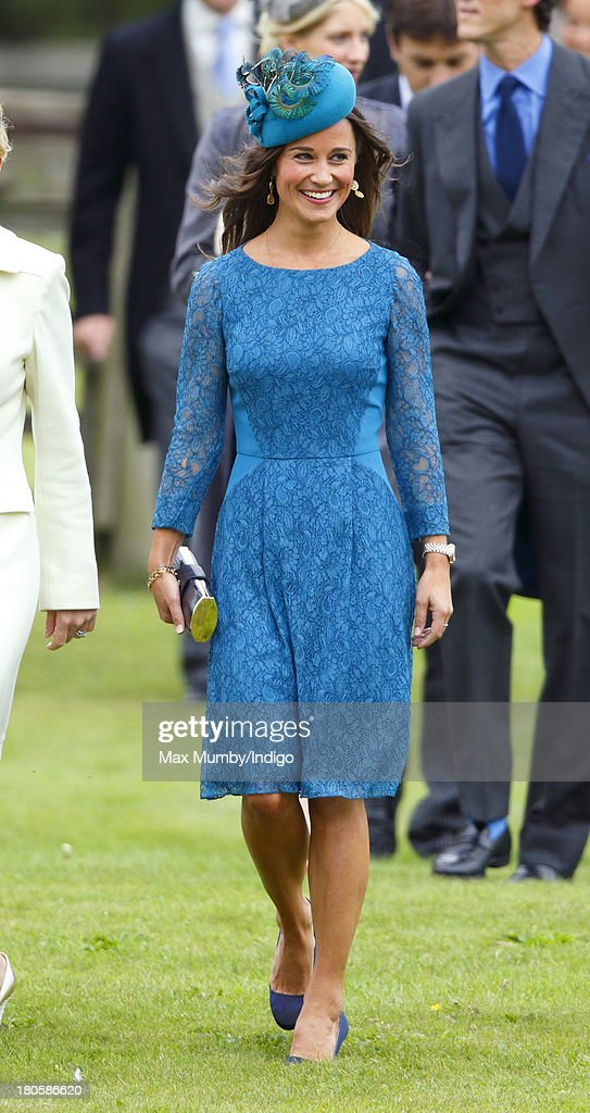 <a gi-track='captionPersonalityLinkClicked' href=/galleries/search?phrase=Pippa+Middleton&family=editorial&specificpeople=4289296 ng-click='$event.stopPropagation()'>Pippa Middleton</a> attends the wedding of James Meade and Lady Laura Marsham at the Parish Church of St. Nicholas in Gayton on September 14, 2013 near King's Lynn, England.