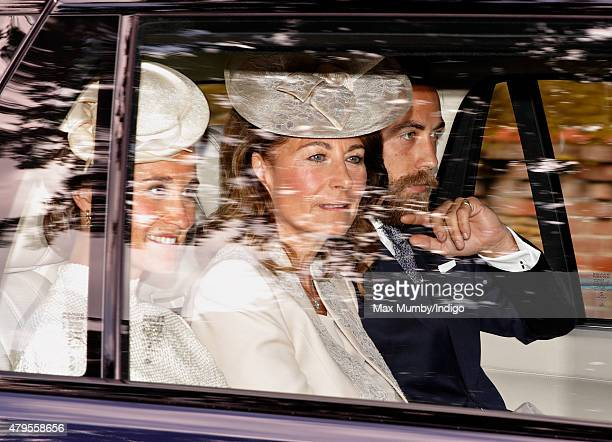 Pippa Middleton Carole Middleton and James Middleton attend the christening of Princess Charlotte of Cambridge at the church of St Mary Magdalene on...