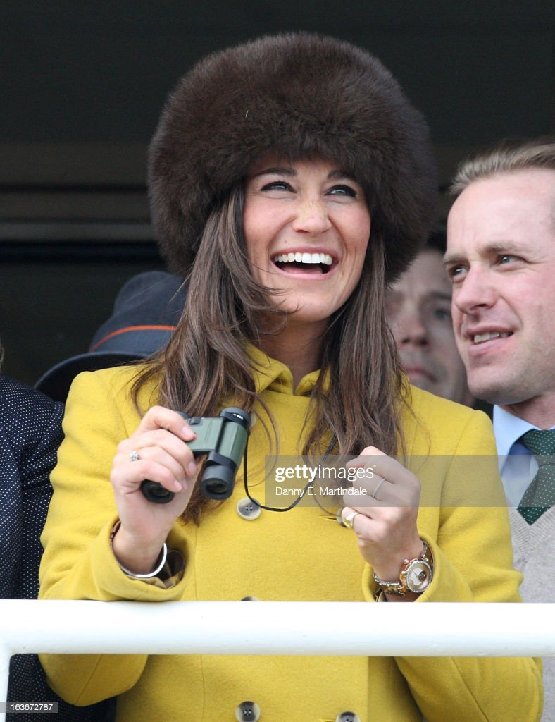 Pippa Middleton celebrates as she watches the Queens Mother Steeple Chase on day 3 of the Cheltenham Festival at Cheltenham Racecourse on March 14, 2013 in Cheltenham, England.