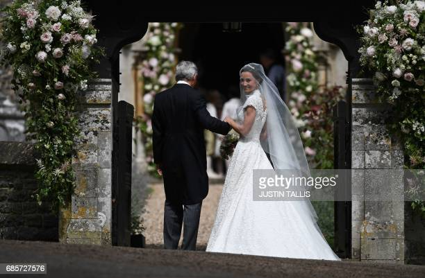 Pippa Middleton is escorted by her father Michael Middleton as she arrives for her wedding to James Matthews at St Mark's Church in Englefield west...