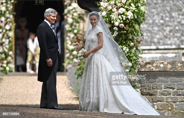 Pippa Middleton is escorted by her father Michael Middleton as she arrives for her wedding to James Matthews at St Mark's Church on May 20 2017 in...