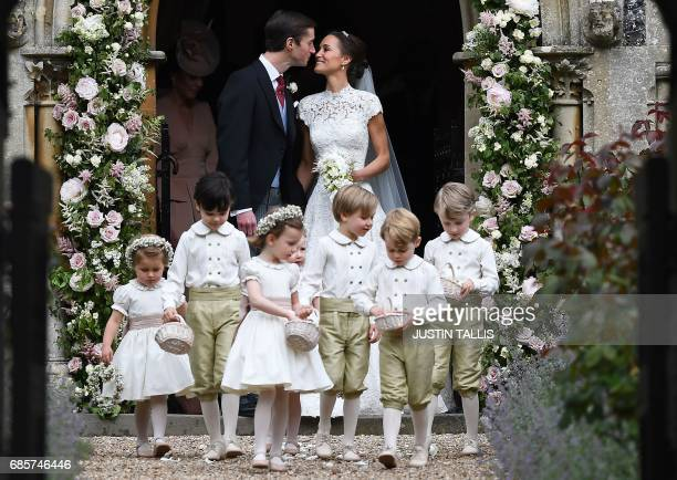 TOPSHOT Pippa Middleton kisses her new husband James Matthews following their wedding ceremony at St Mark's Church in Englefield west of London on...